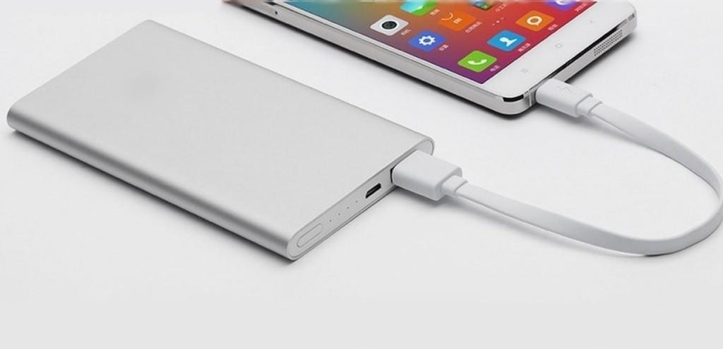 Plain white powerbank plugged into smartphone